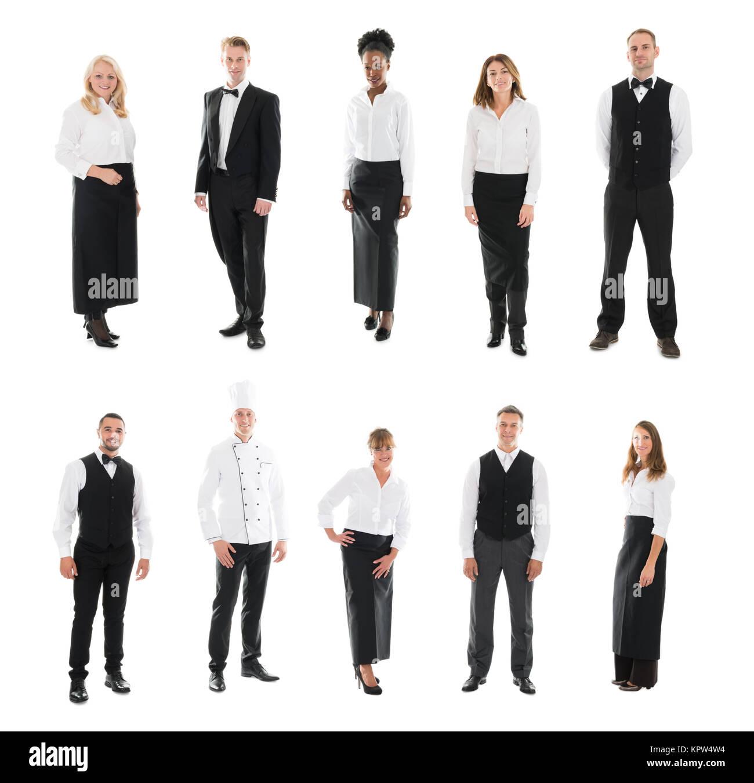 Multi ethnic Restaurant Staff Standing Against White Background - Stock Image