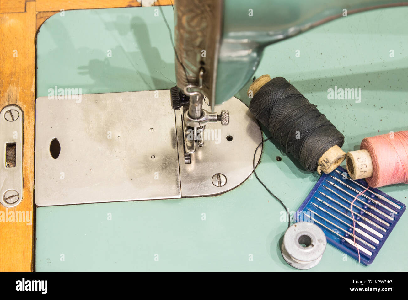 This is a very old sewing machine and is still in a working condition - Stock Image