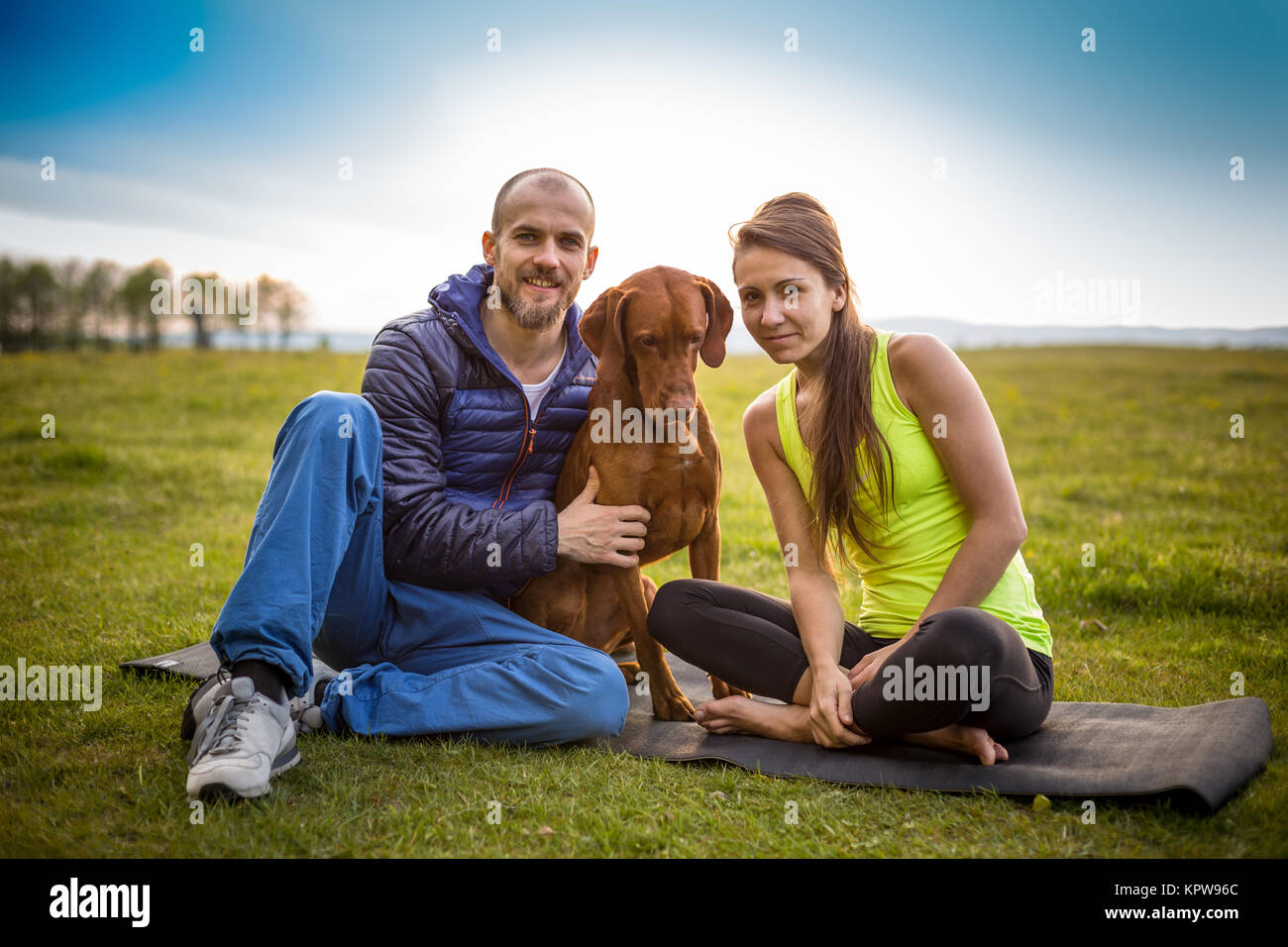 Couple with a dog - Stock Image
