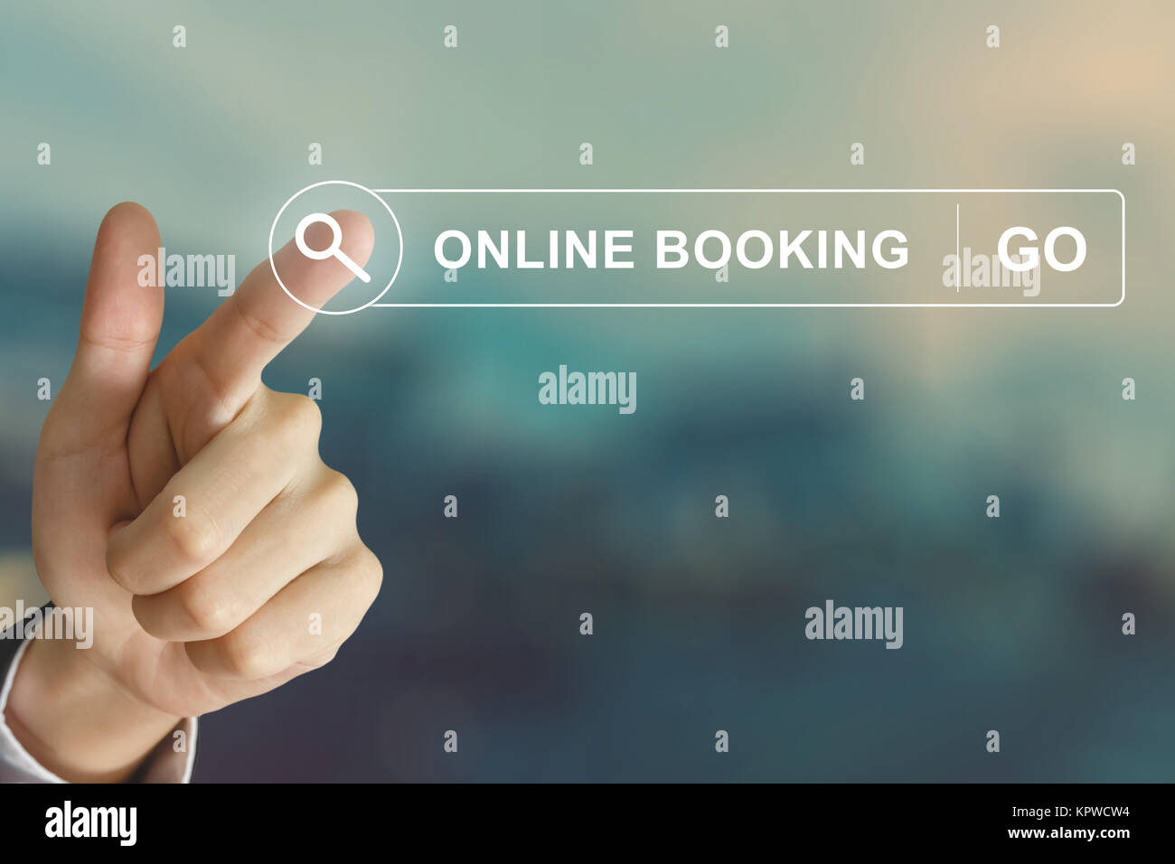 business hand clicking online booking button on search toolbar - Stock Image