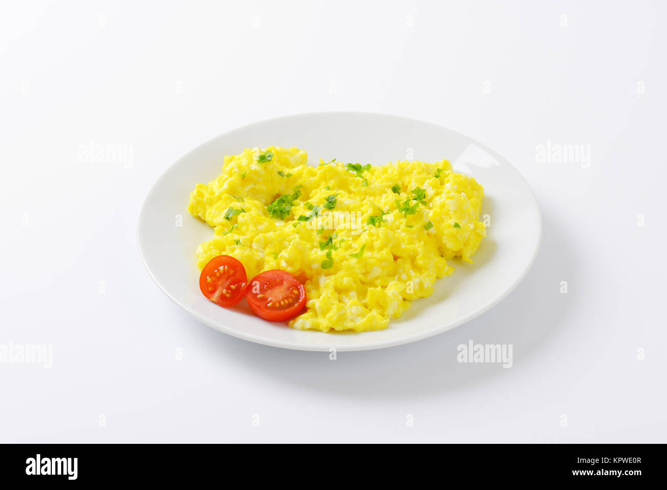 plate of scrambled eggs - Stock Image