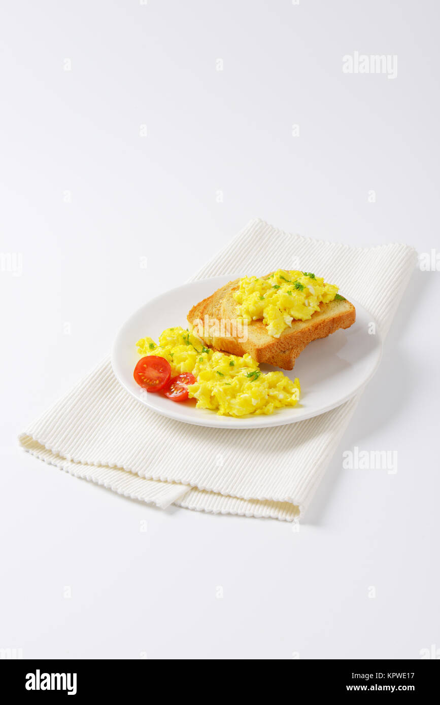 scrambled eggs with toast - Stock Image