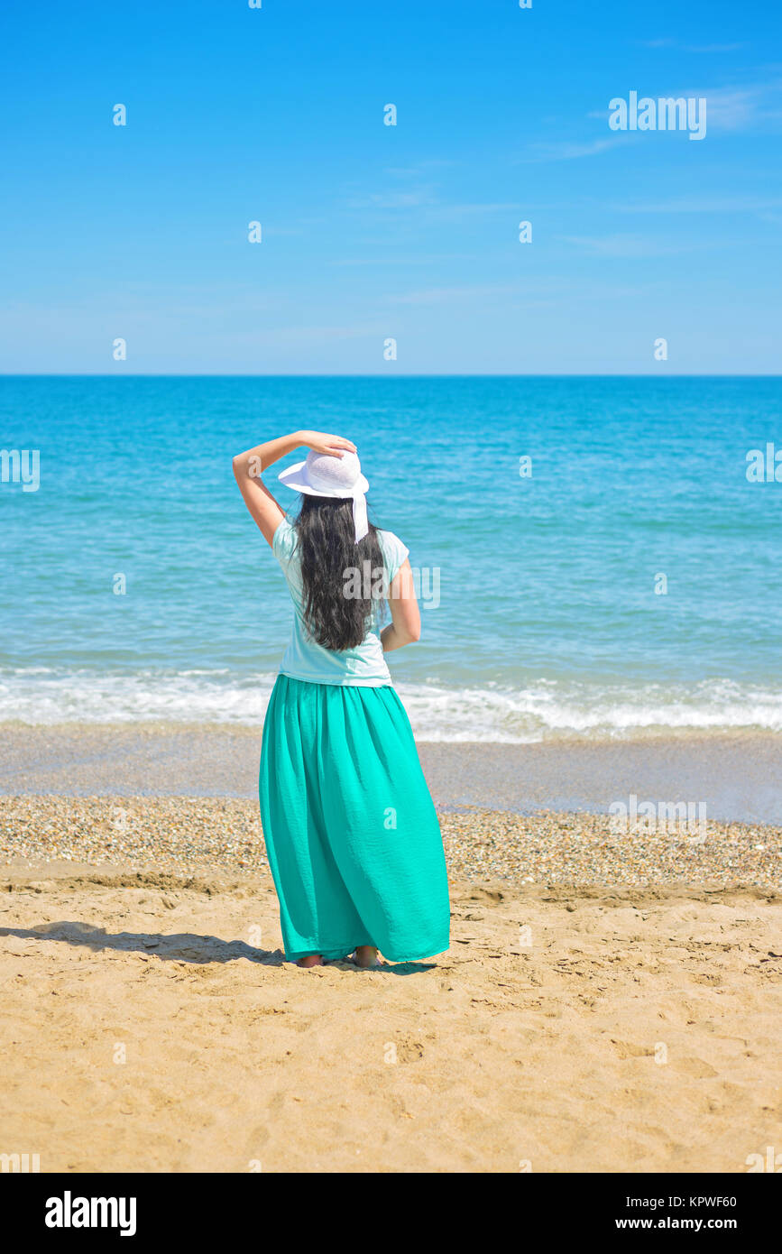 Brunette with long hair turned away Stock Photo