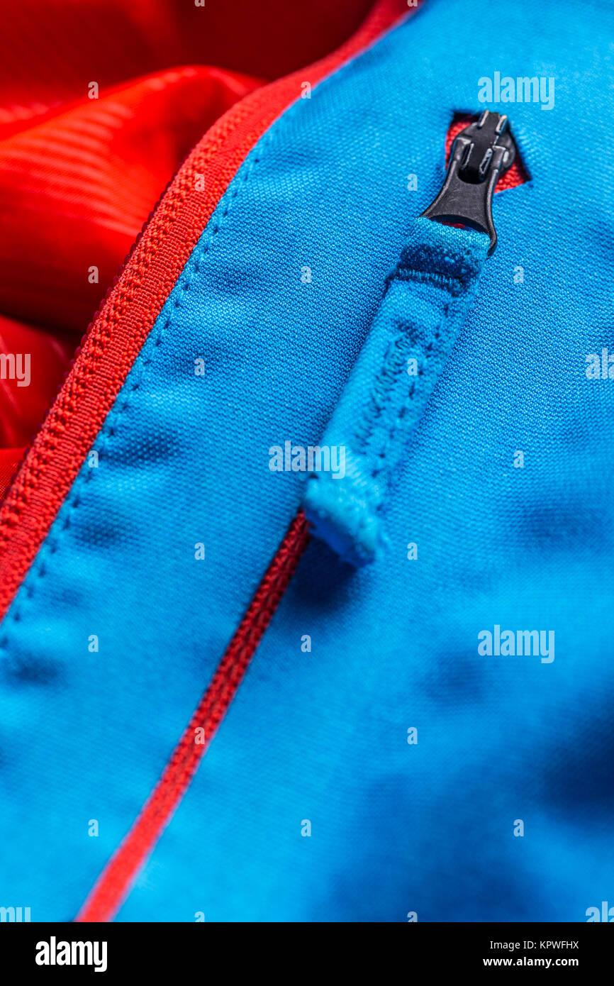 Zippered blue coat pocket - Stock Image