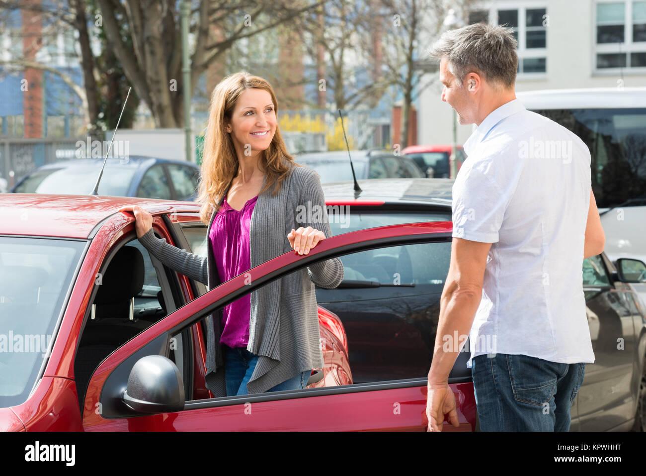 Couple Standing By New Car Door - Stock Image