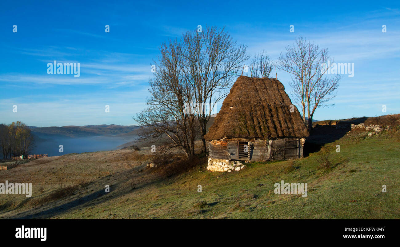 Small cottage in the mountains-panoramic view - Stock Image