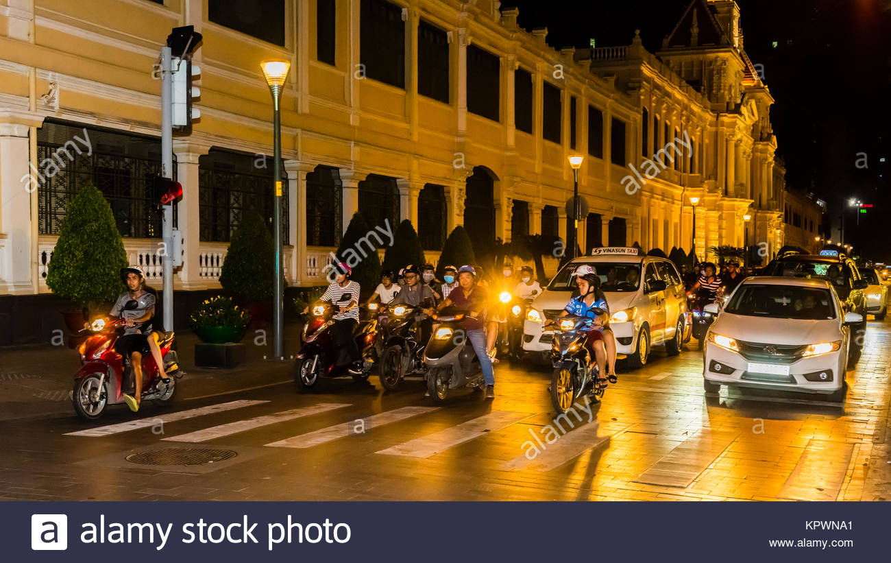 Two-wheeled traffic in Ho Chi Minh City (Saigon), Vietnam. There are over four million motorbikes in the city. - Stock Image