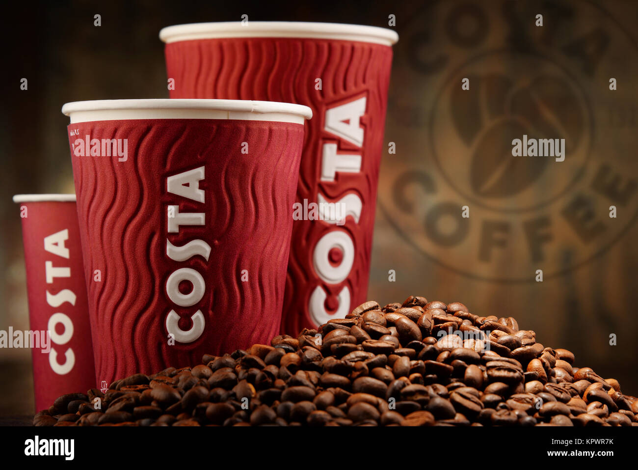 Composition with cups of Costa Coffee coffee and beans - Stock Image