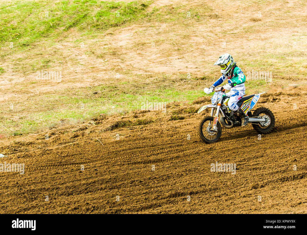 Extreme sport. A child on a motorcycle rides the sand. Motocross ...