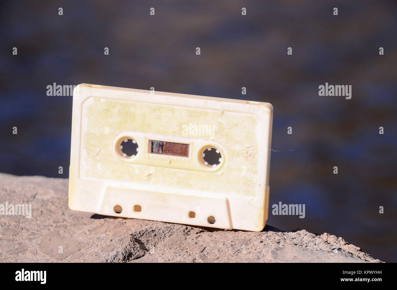 Ancient Retro Musicassette on the Rock into the Wild - Stock Image