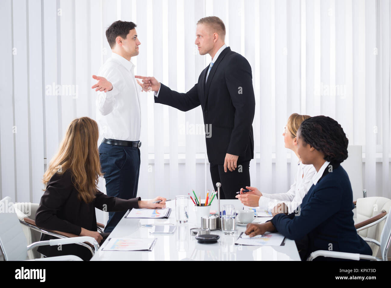 Businessman Blaming His Colleague In Meeting Stock Photo