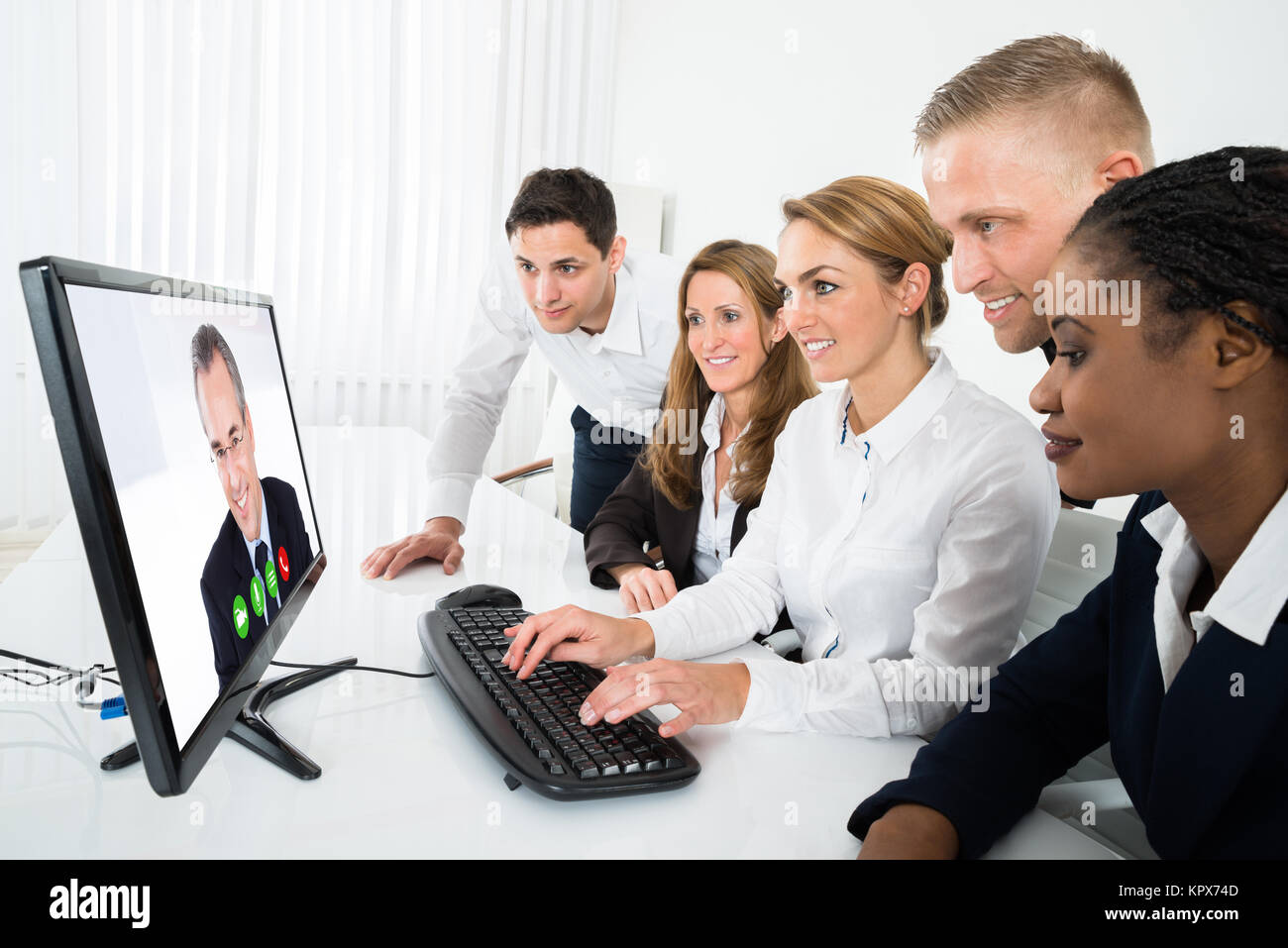 Businesspeople Videoconferencing On Computer - Stock Image