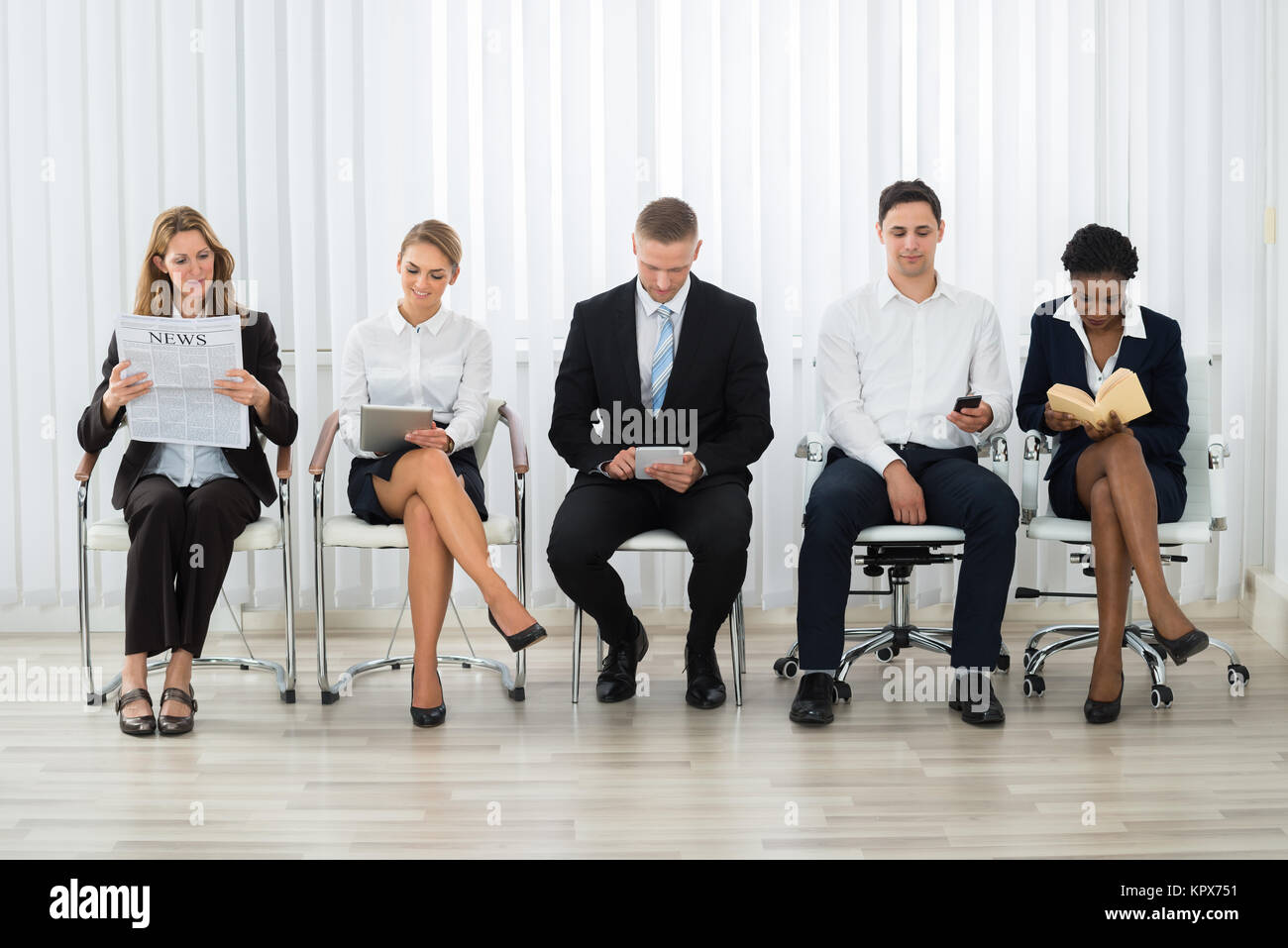 Businesspeople Waiting For Interview - Stock Image
