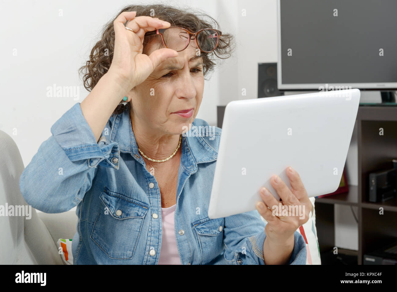 a middle-aged woman with eyes pain Stock Photo