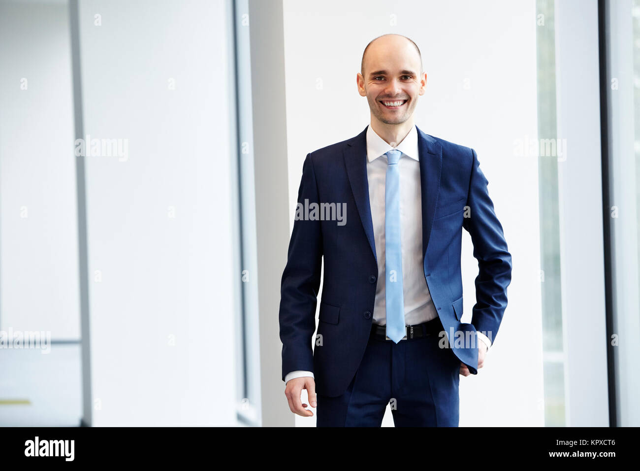 Cheerful young businessman in the office - Stock Image