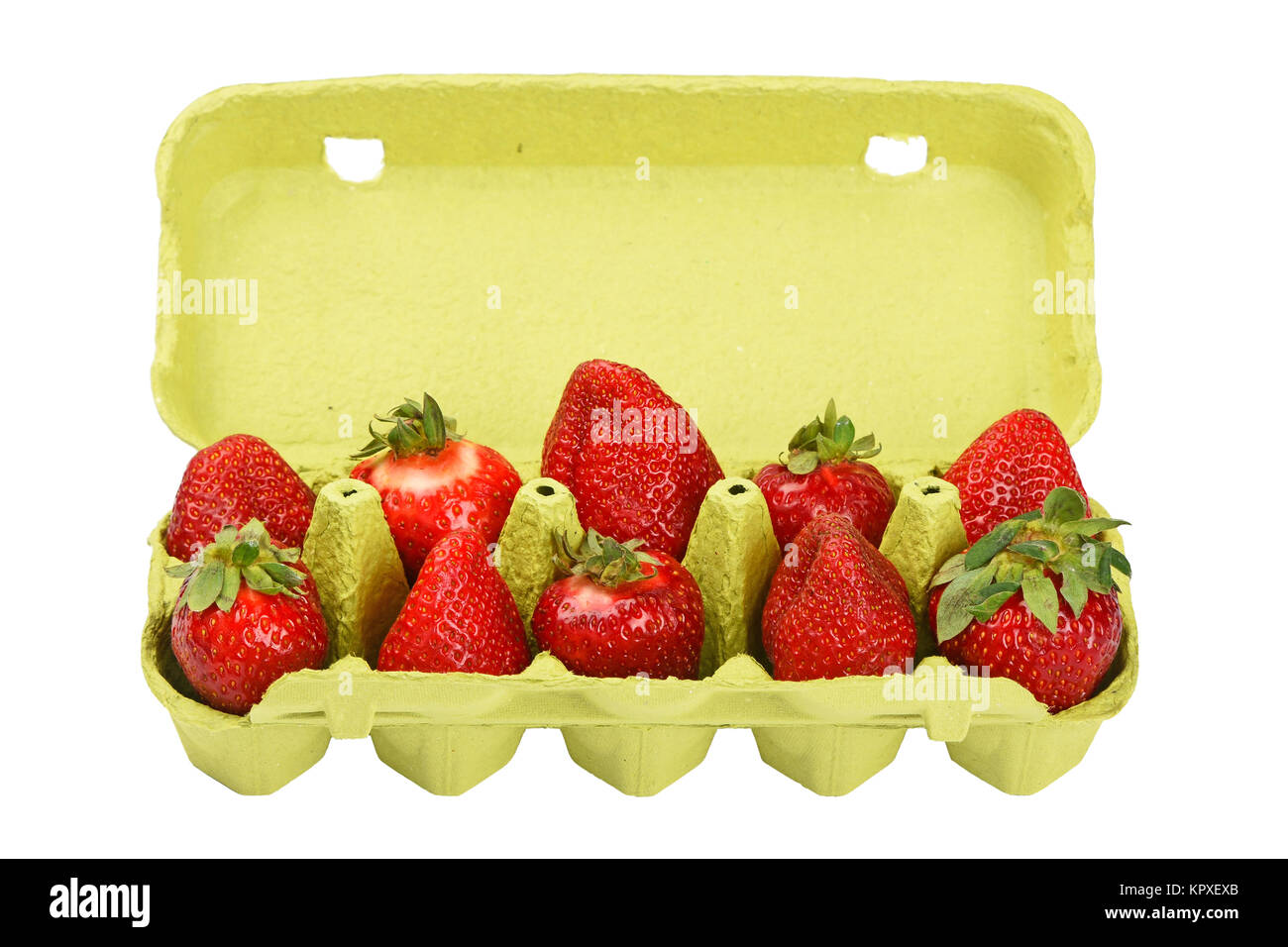 Strawberry in open green egg carrier over white - Stock Image