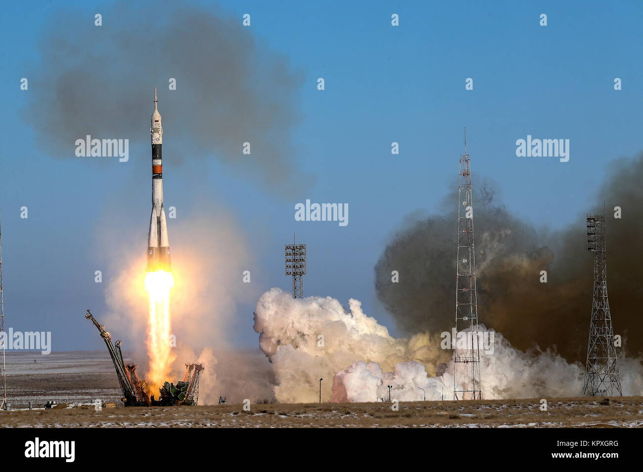 Baikonur, Kazakhstan. 17th Dec, 2017. A Soyuz-FG booster rocket carrying the Soyuz MS-07 spacecraft launched from - Stock Image
