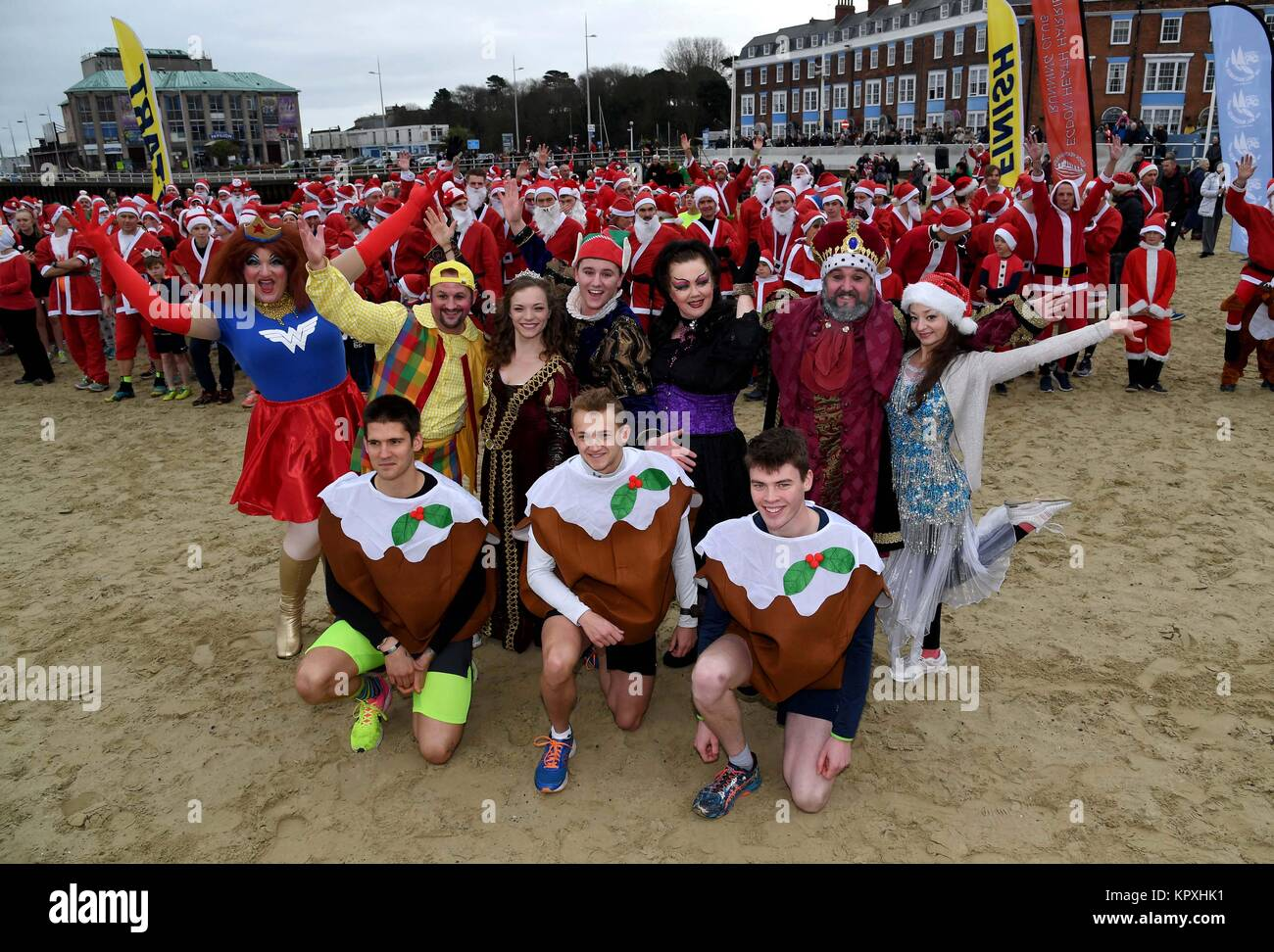 Chase the Pudding Santa race on Weymouth beach, Dorset, UK Credit: Finnbarr Webster/Alamy Live News - Stock Image