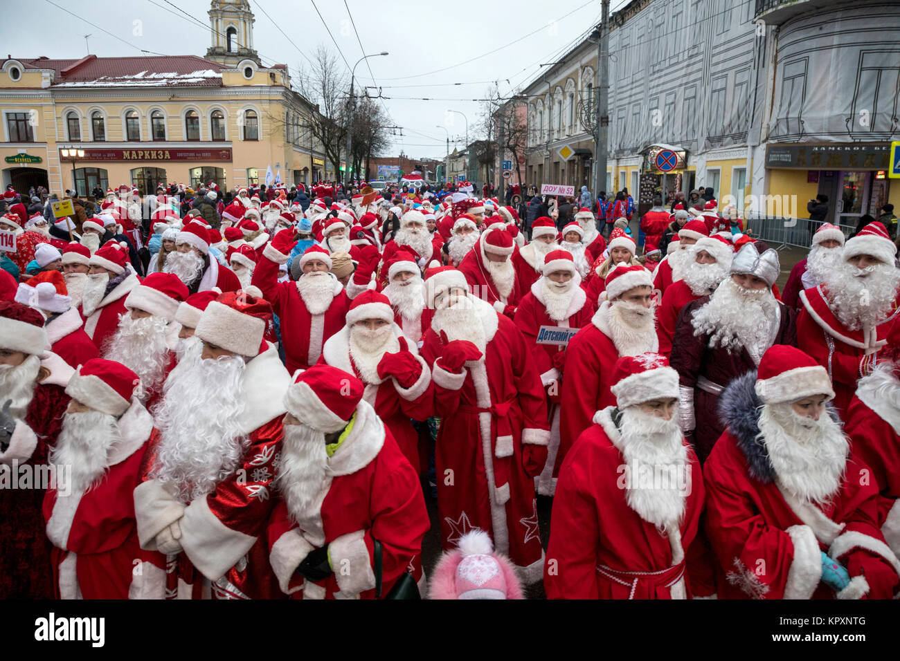 Participants during an annual holiday procession of Fathers Frost (Fathers Christmas) on central street in Rybinsk Stock Photo