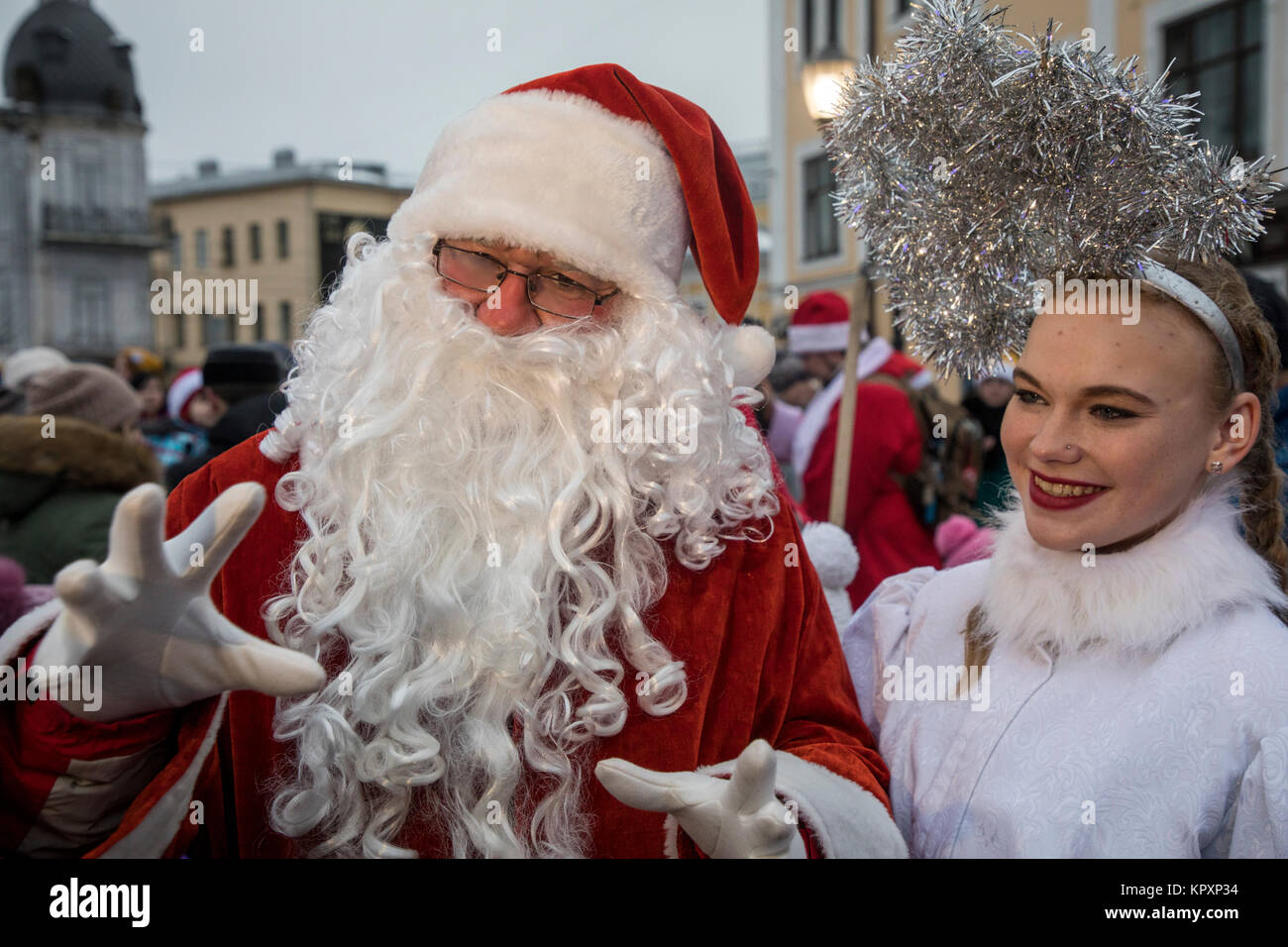 American santa claus and russian snow maiden takes part of