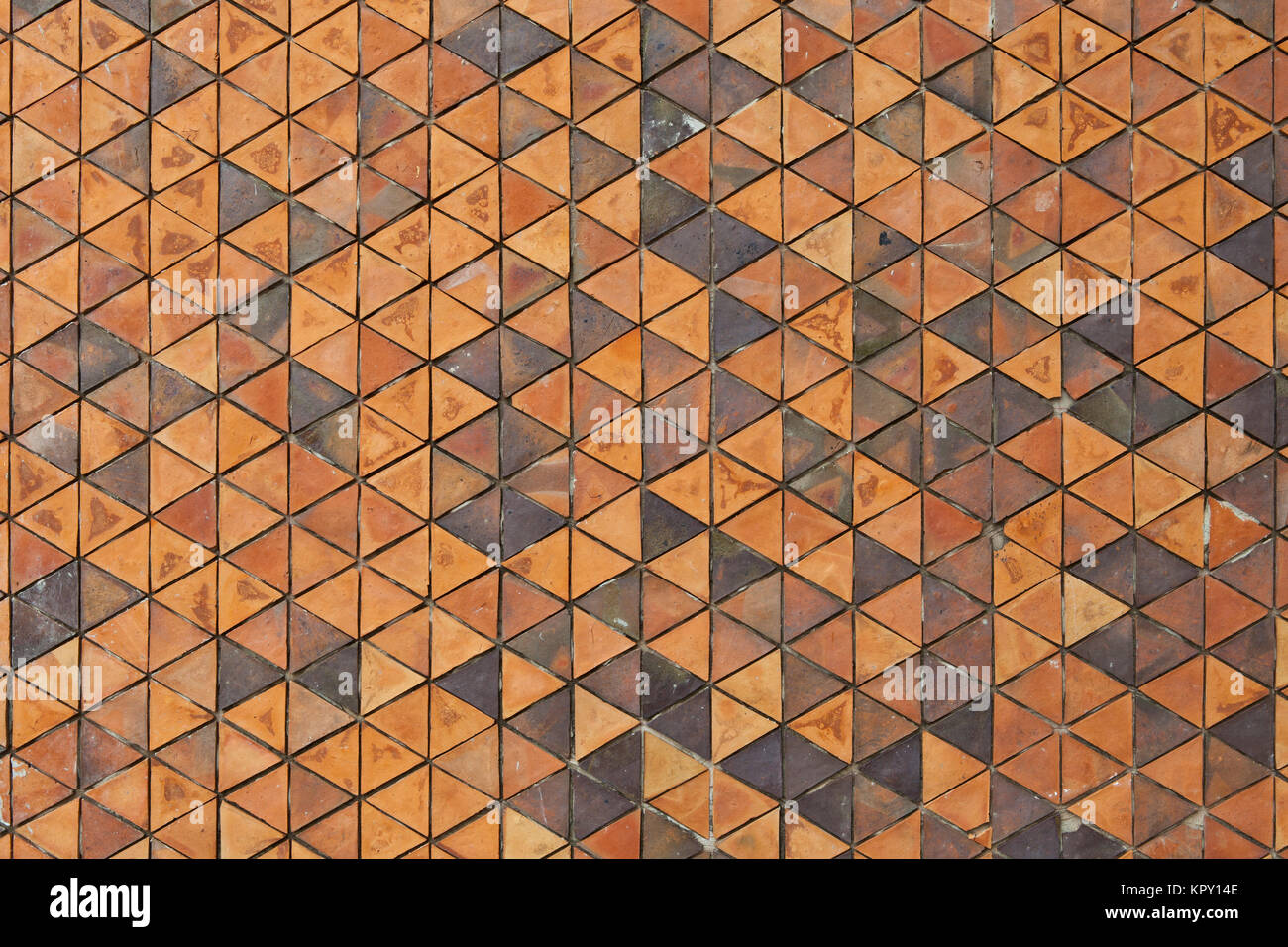Pattern of triangular clay tiles background, orange wall, terra