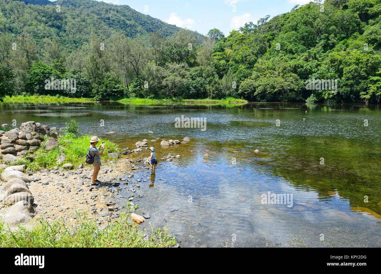 Mother taking a picture of her son at Lake Placid, Cairns, Far North Queensland, FNQ, QLD, Australia - Stock Image