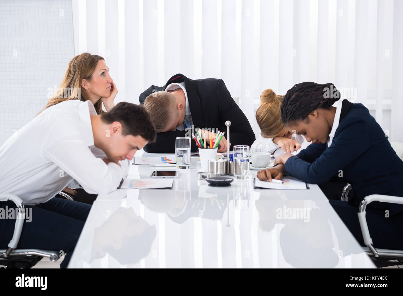 Businesspeople Sitting In Business Meeting - Stock Image