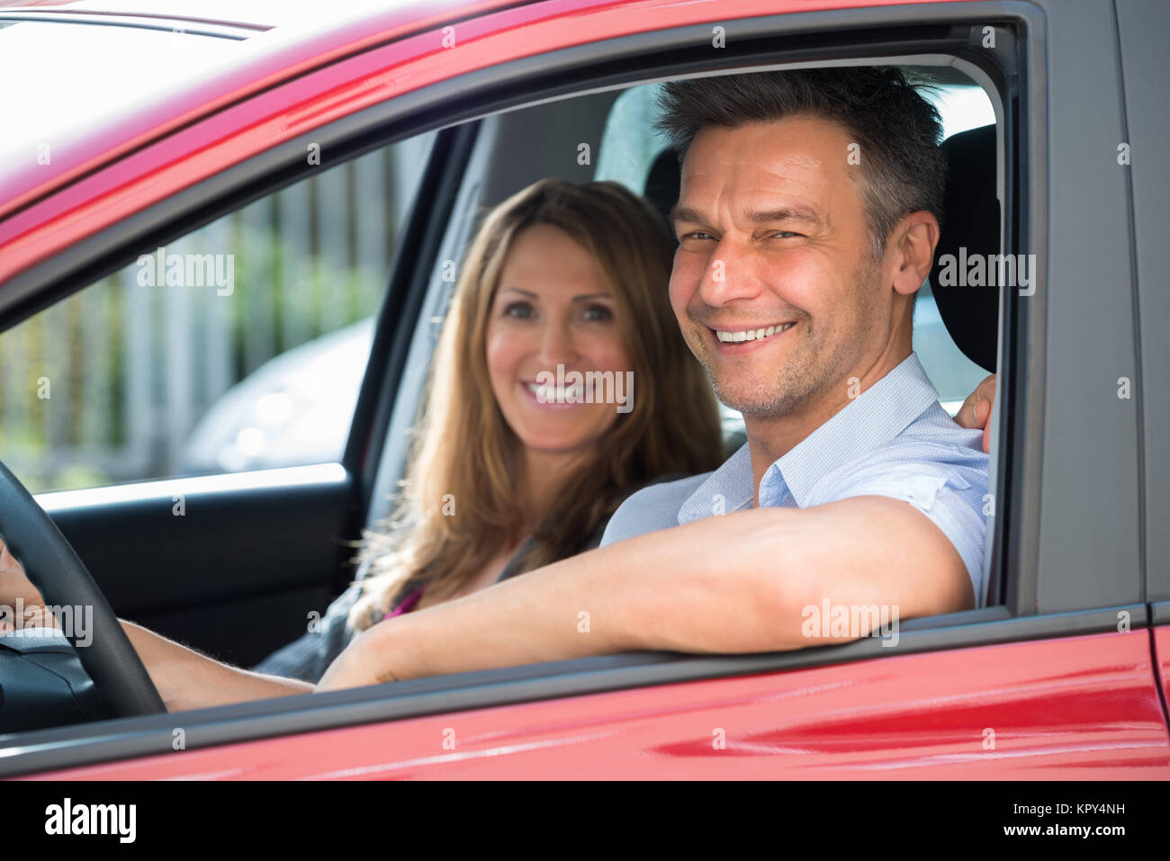 Couple Sitting Inside The Car - Stock Image