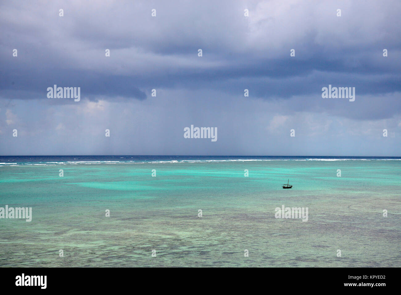Zanzibar is an Indian Ocean paradise that most people can afford to visit for lazy holidays on warm beaches. - Stock Image