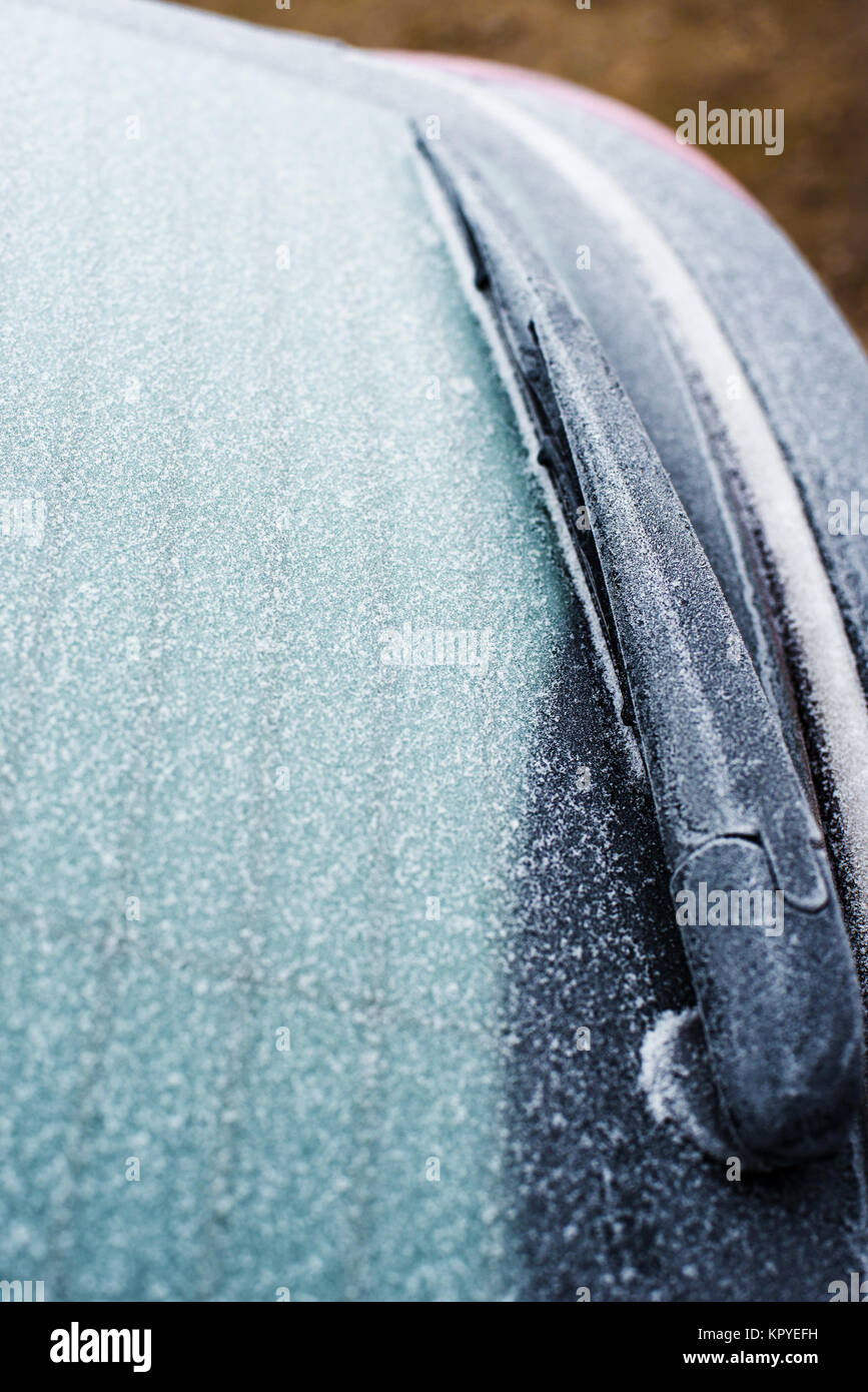 Car glass cleaner car brush with frost at shallow depth of field - Stock Image
