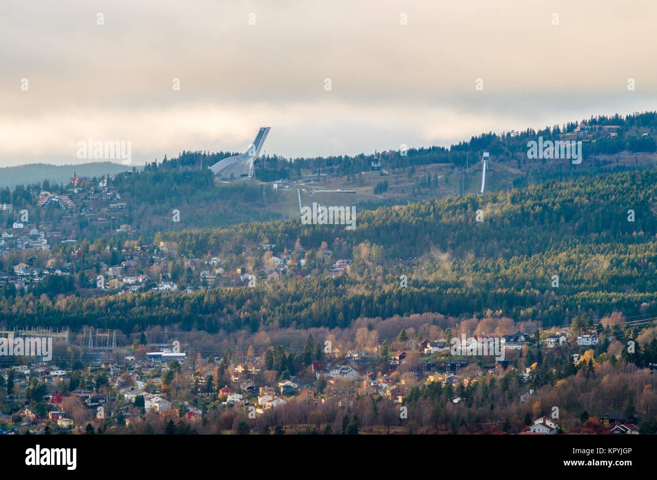 General, long distance view of Holmenkollen ski jumping center with Holmenkollbakken and Holmenkollen Chapell, just - Stock Image