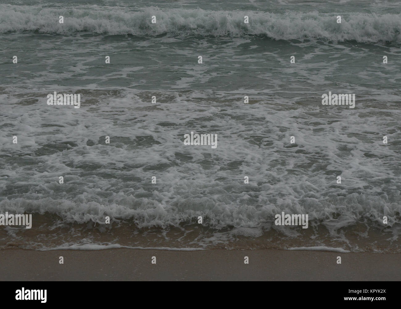 Waves on the beach - Stock Image