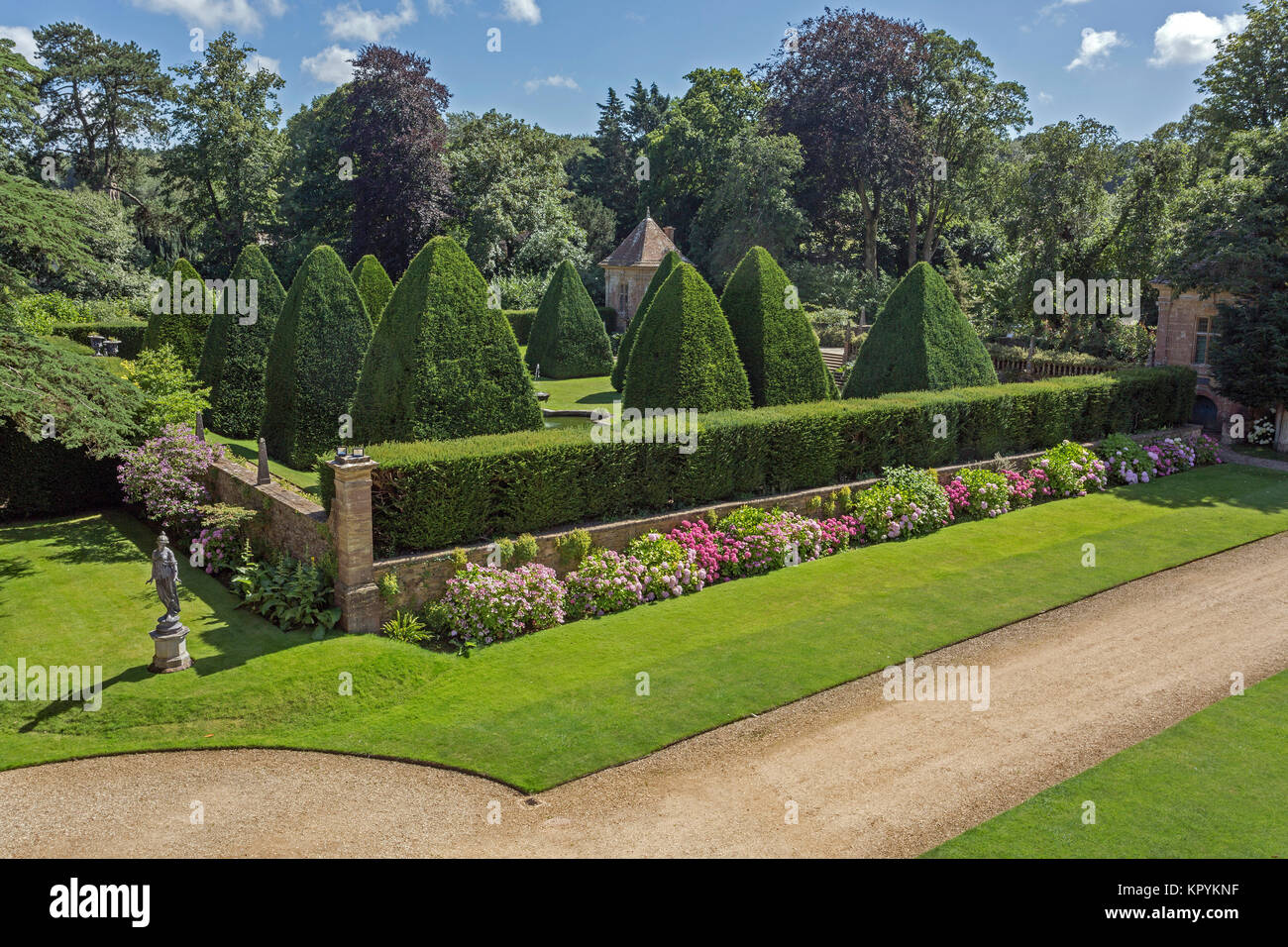 The giant yew pyramids in the Great Court at Athelhampton House, Puddletown, Dorset, England, UK - Stock Image
