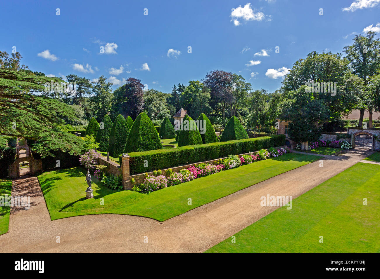 The giant yew pyramids in the Great Court at Athelhampton House, Puddletown, Dorset, England, UK Stock Photo