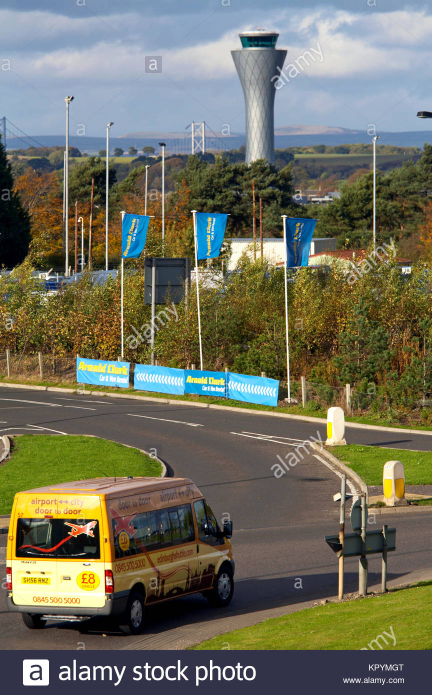 Edinburgh airport shuttle bus and Air Traffic Control Tower, Scotland - Stock Image