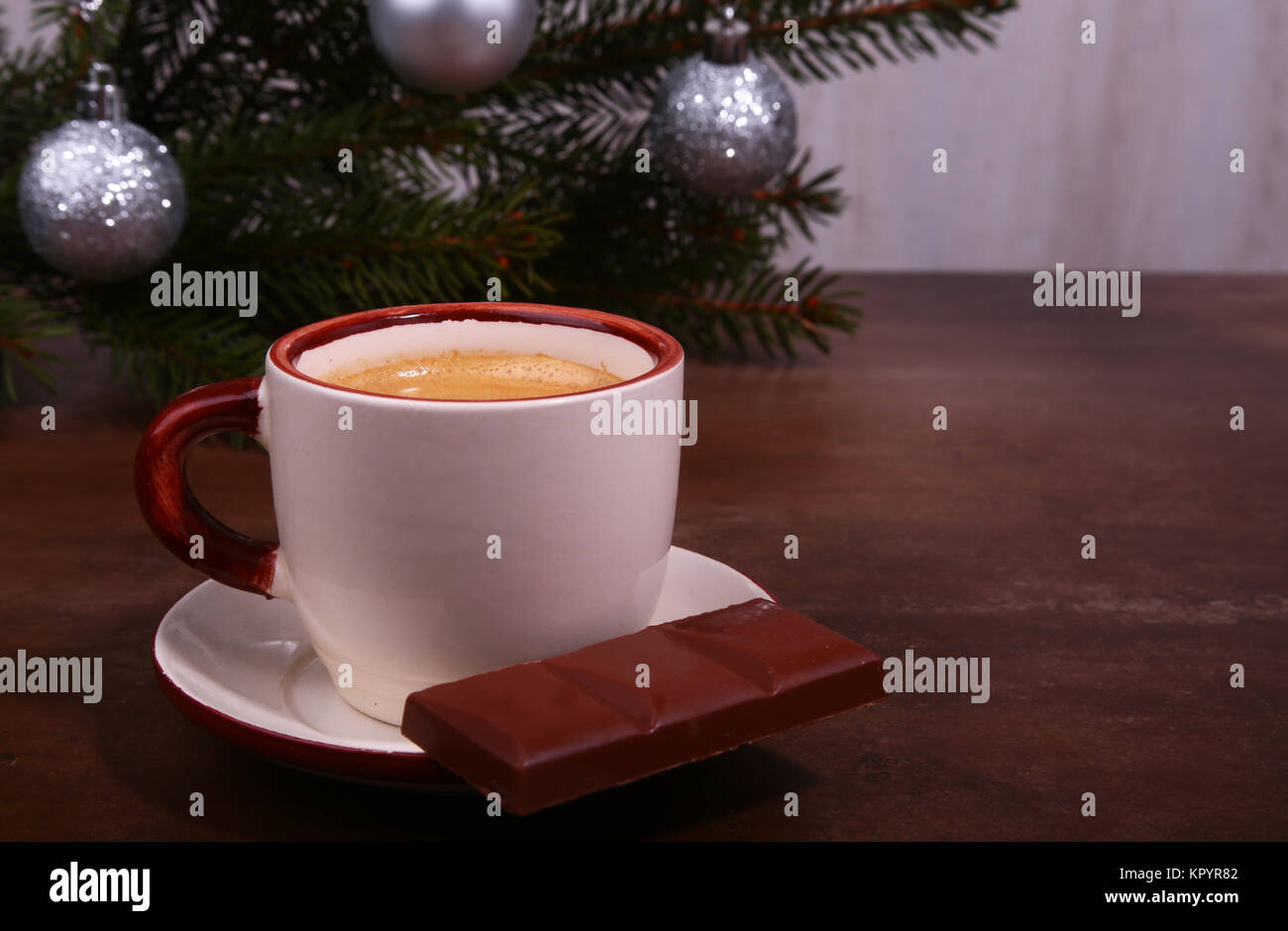 Coffee cup and chocolate on wooden table texture. Coffeebreak. Christmas time - Stock Image
