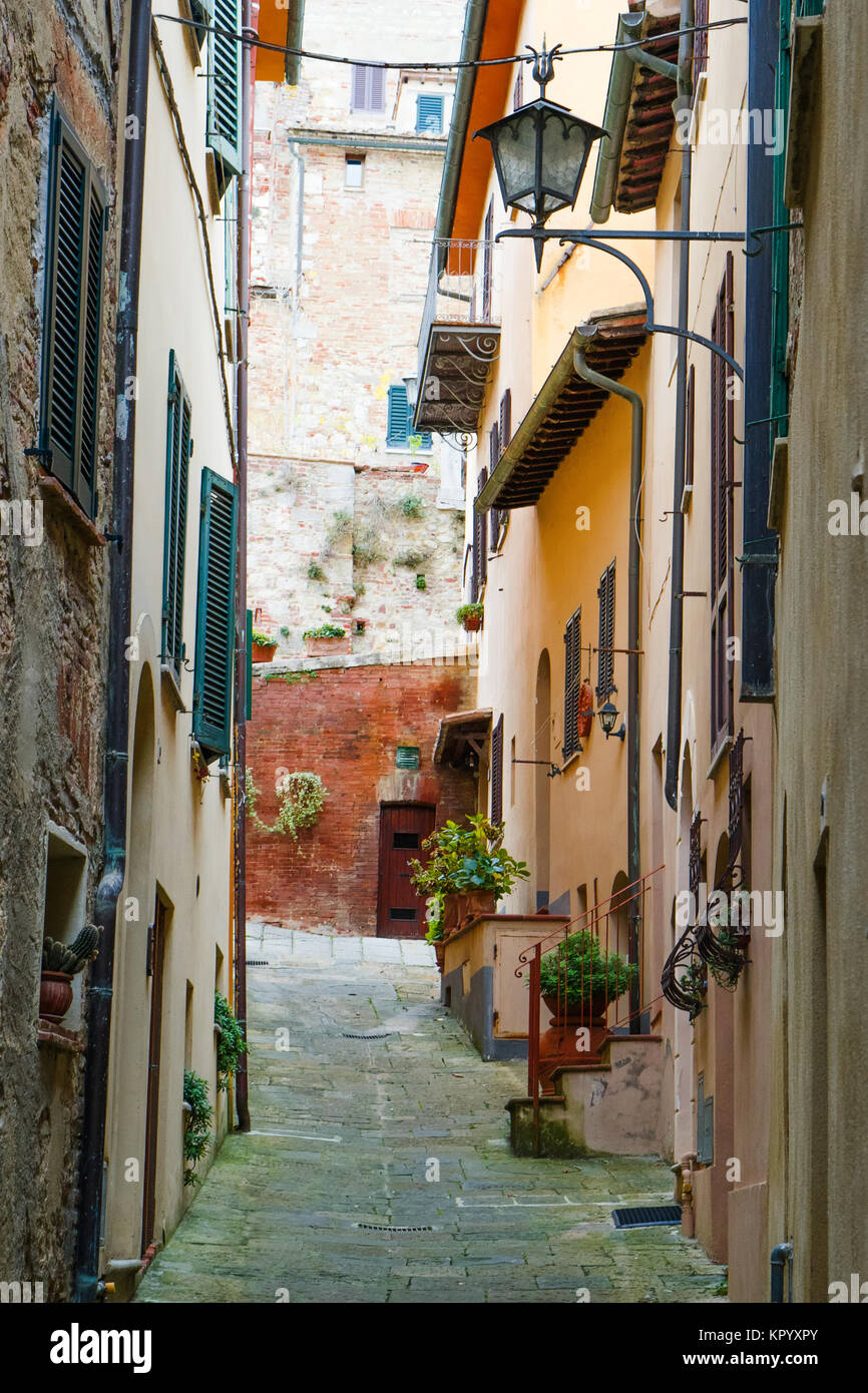 Typical characteristic narrow street in Montepulciano, a medieval and renaissance hill town near Siena, Tuscany, - Stock Image