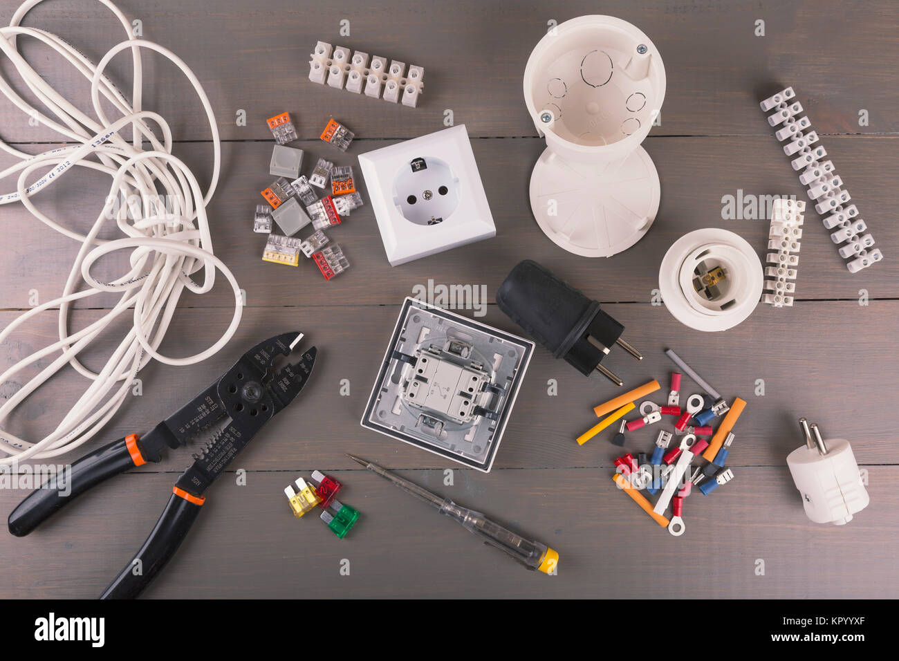 Awesome Electrical Tools And Accessories On Wooden Table Stock Photo Wiring Cloud Hisonuggs Outletorg