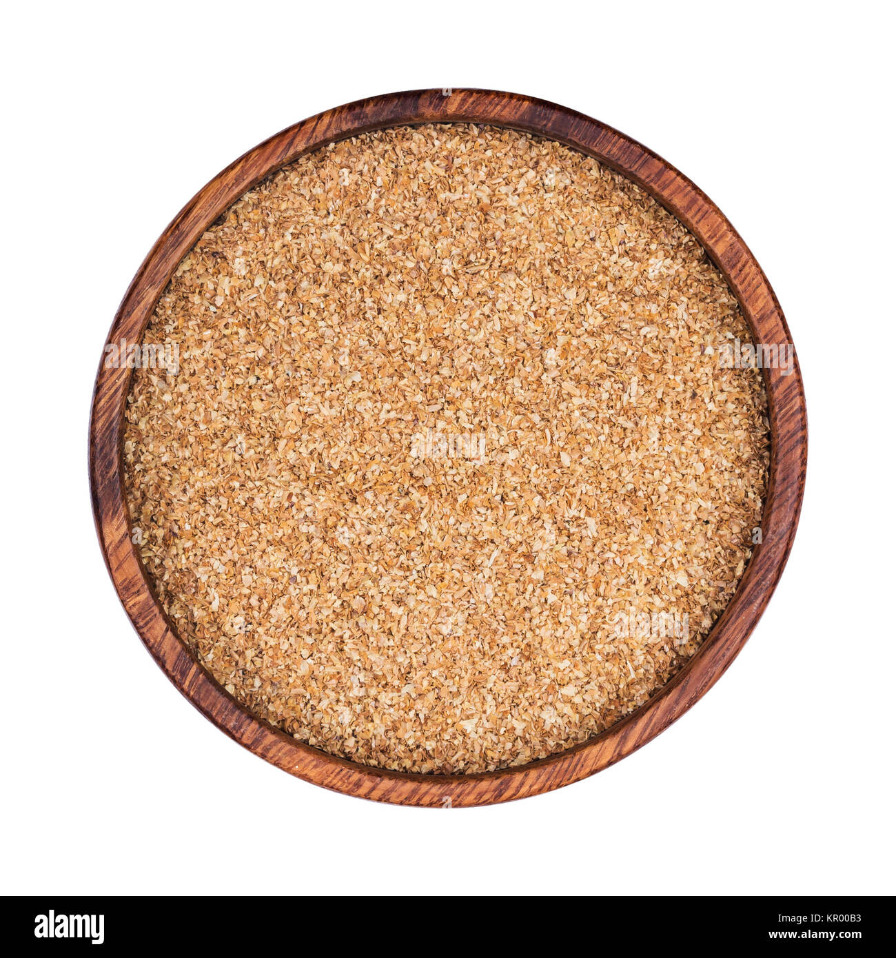 Dry ground fiber in bowl isolated on white background. Top view - Stock Image