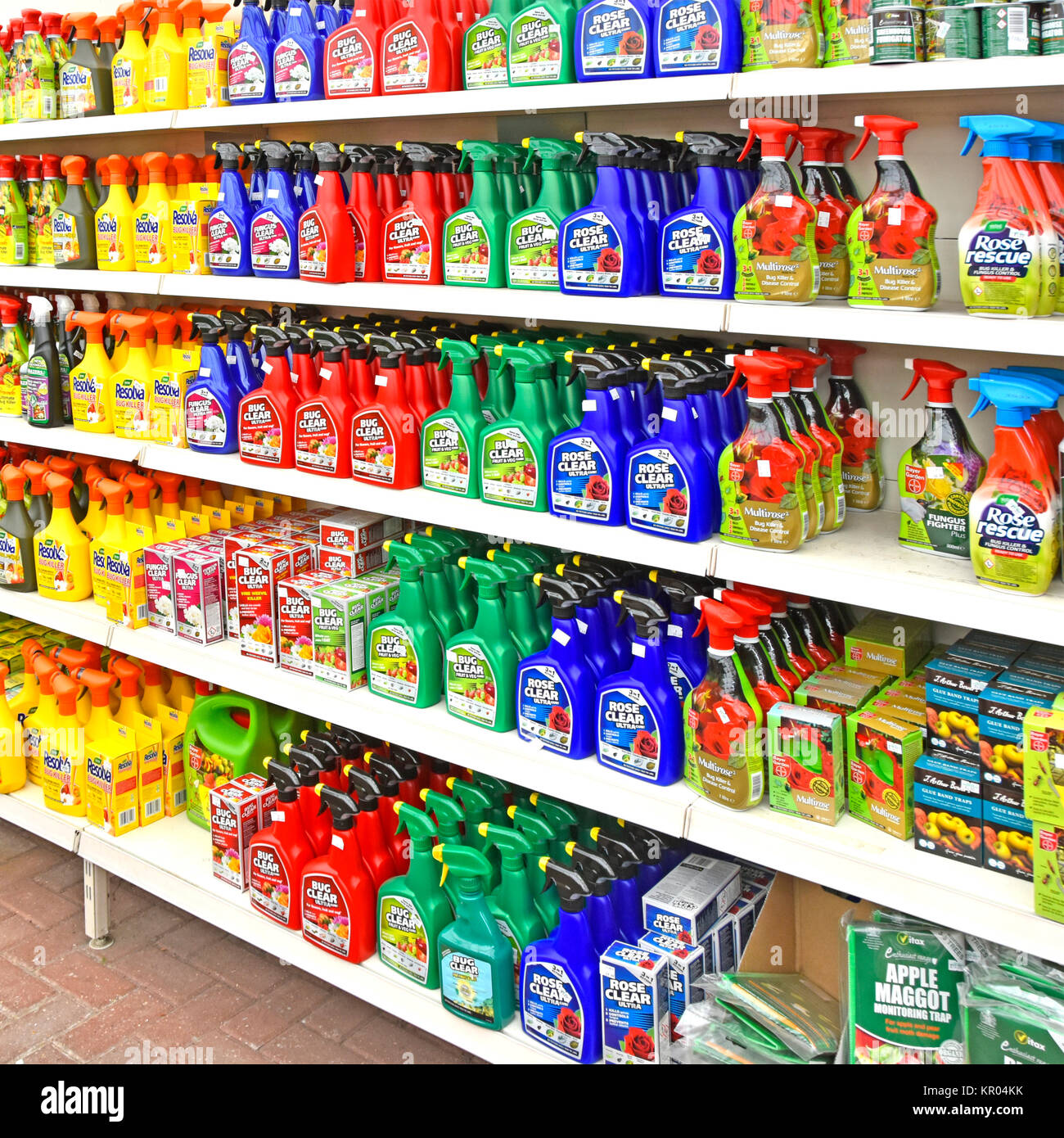 Garden centre shelf gardening chemical plastic spray bottles of weedkillers pest control of bugs general garden - Stock Image