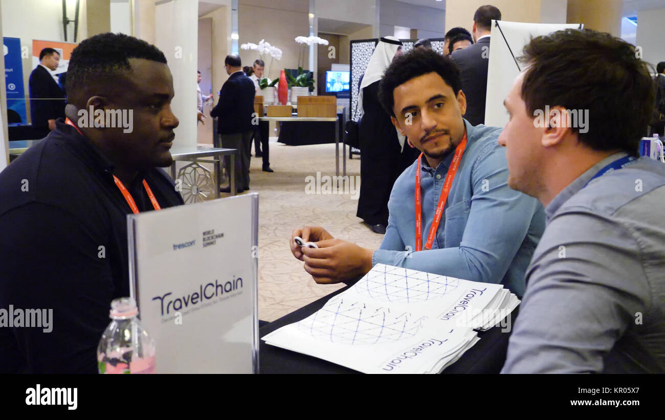 United Arab Emirates, Dubai - October 2017: Travel Chain. People sit and talk at the summit on the blockchain. Ideas, - Stock Image