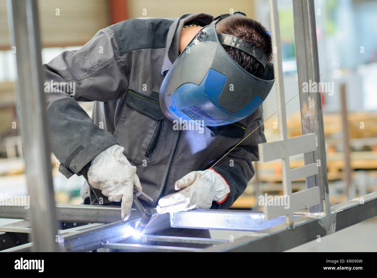 welder with blow torch - Stock Image