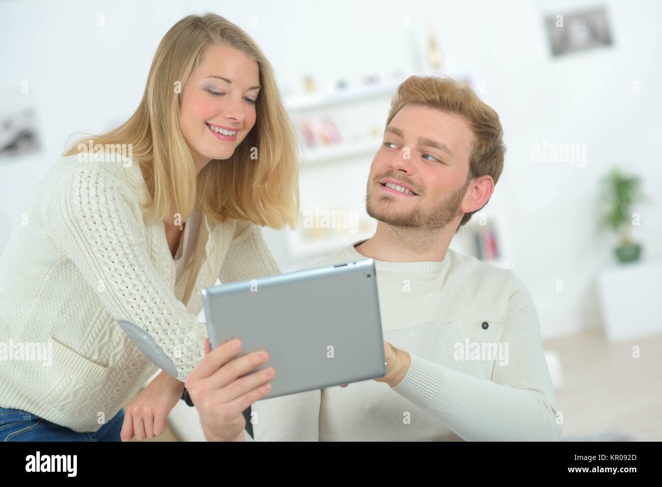Couple in love with their tablet - Stock Image