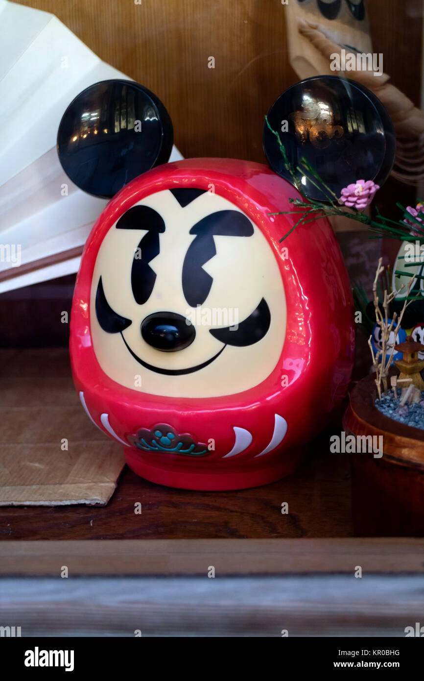 Tokyo - Japan, May 15, 2017: Daruma doll with a Mickey Mouse shape, Japanese traditional doll modeled from papier - Stock Image