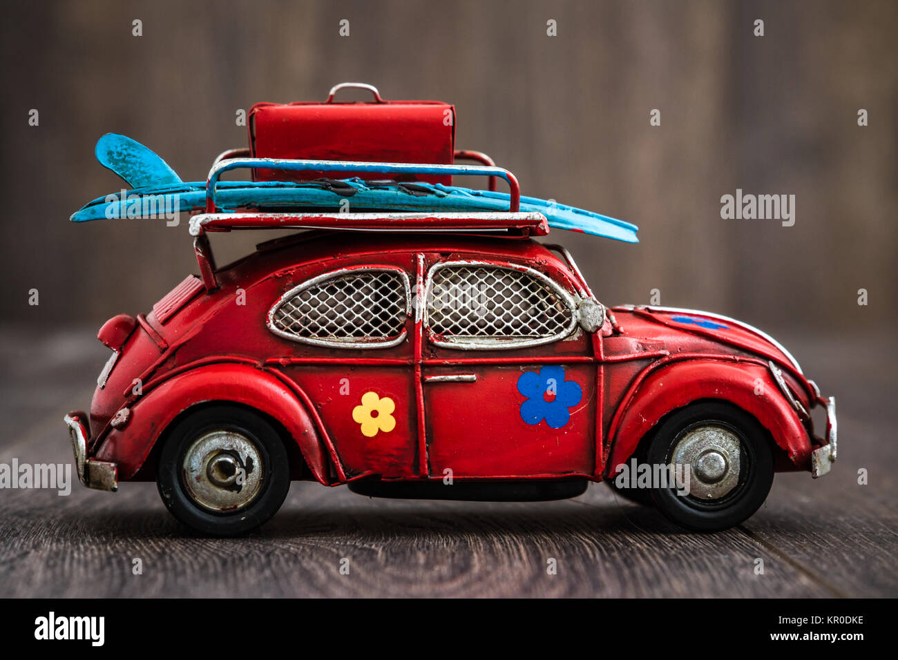 Classic Mini Red Car Model on Brown Background - Stock Image