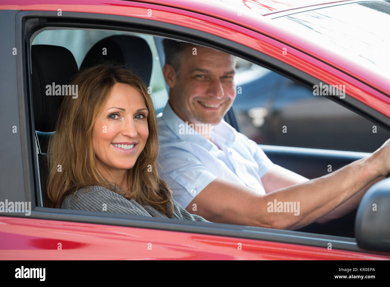 Couple Sitting In Car - Stock Image