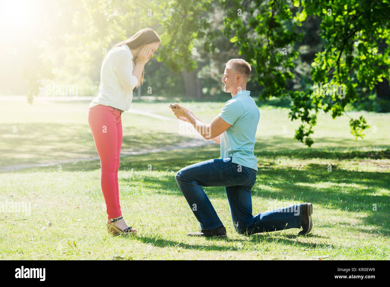Man Making Proposal To Woman - Stock Image
