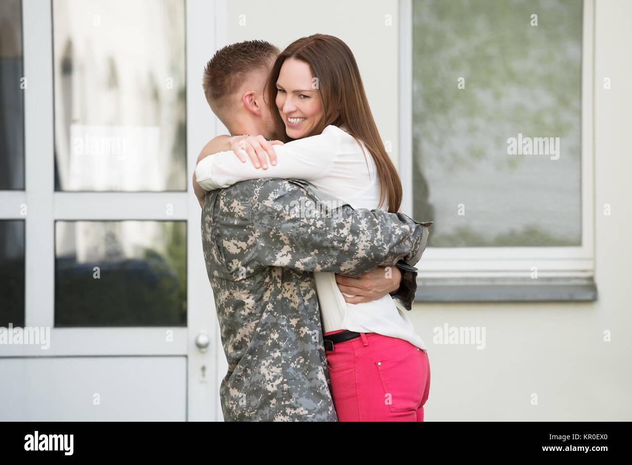 Wife Welcoming Her Husband - Stock Image