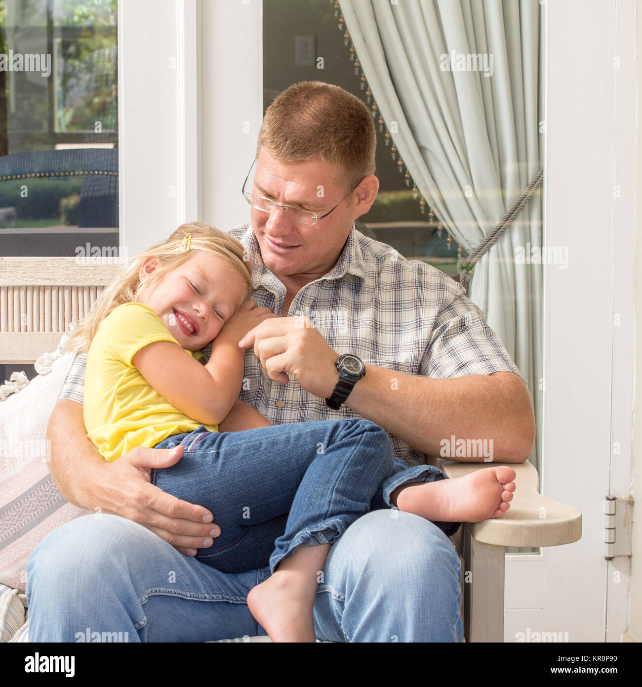 Father and daughter together on patio - Stock Image