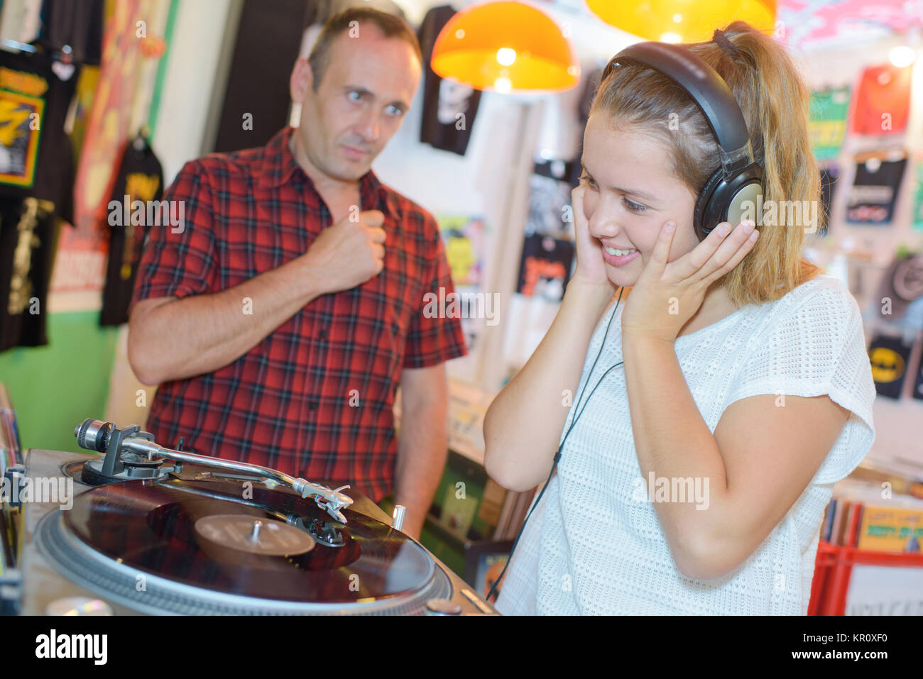 teen listening to the music on the records - Stock Image